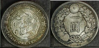 JAPAN One Yen - Meiji Year 25 (1892) - Almost Uncirculated with toning [J-02]