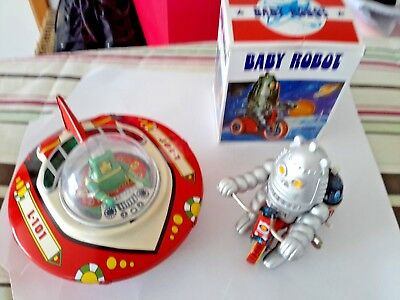tin toys flying saucer  and a baby robot both in great condition
