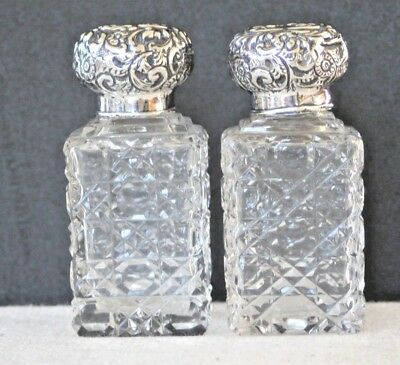 Vintage pair of sterling silver topped dressing table scent bottles London 1901