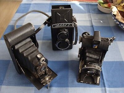 Job lot of vintage film cameras and cases