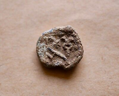 BYZANTINE LEAD SEAL/ BLEISIEGEL WITH BLOCK MONOGRAM IN EITHER SIDE (6th cent.).