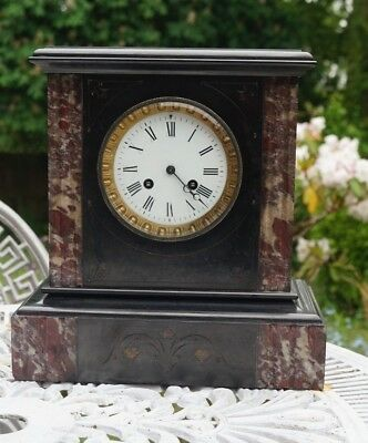 French slate / marble mantel clock striking on a bell