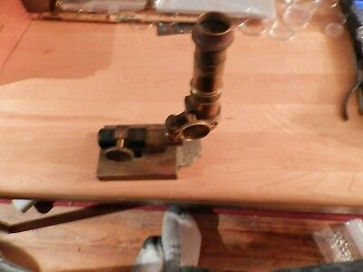 rare antique microscope... solid brass...with lead in its base
