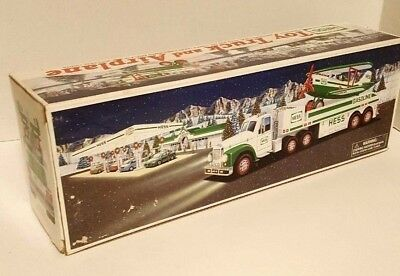NEW IN BOX 2002 Hess Toy Truck and Motorized Airplane Battery Head & Tail Light