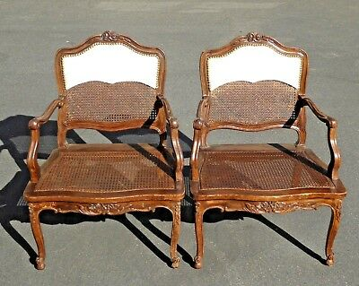 Pair of Vintage French Provincial Carved Wood Cane Arm Chairs