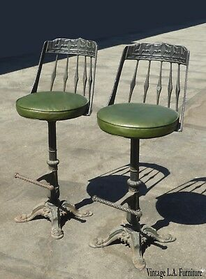 Set of Two Vintage Spanish Style Green Swivel Cast Iron Bar Stools