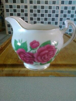 Bone china milk jug by Royal Vale White with roses gilded edges