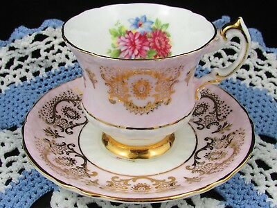 Paragon Pink Floral Fancy Gold Designs Embossed Pink Tea Cup And Saucer