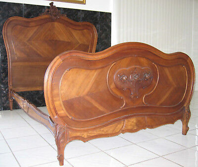 French Louis XV style bedframe, rosewood, circa 1890-1900 with nightstand.