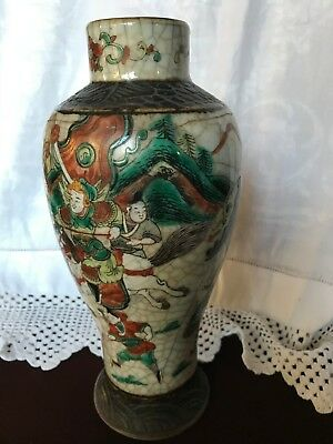 Chinese Nankin style warriors crackle glaze vase with damage