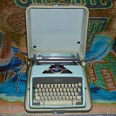 Vintage Blue Olympia SM7 Deluxe Portable Typewriter with the Case - Works Great