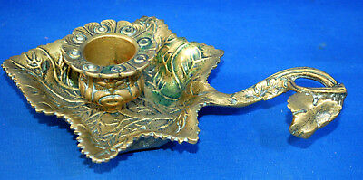 A super detailed Victorian brass or bronze ivy leaf chamber candlestick