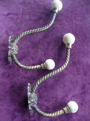 Antique Victorian matching pair rope twist brass and porcelain coat hooks