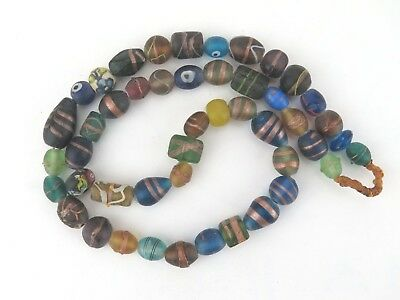 Trade beads. Glass bead strand from Nepal. Beads with gold bands.