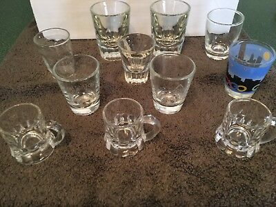 Set Of 11 Vintage Mostly Clear Glass Shot Glasses Camel Federal Mug Chicago Etch