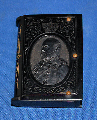 An antique King Edward VII coronation bakelite vesta case, gilding and profile