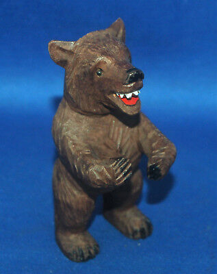 A very well carved antique Victorian small Black Forest bear pen holder figure