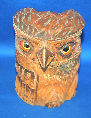 An antique carved wooden Black Forest owll tobacco jar with glass eyes