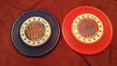 Two Bicentennial Frisbee, one red and one blue Wham-O-Frisbee