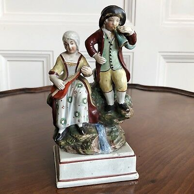 An Early 19th Century Staffordshire Pearlware Pottery Figure Group. 18cm High.