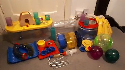 Large hamster cage with several sections toys etc
