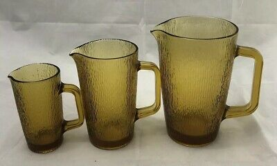 Set Of (3) VINTAGE Amber Textured, Pressed Glass Jugs. Excellent condition.