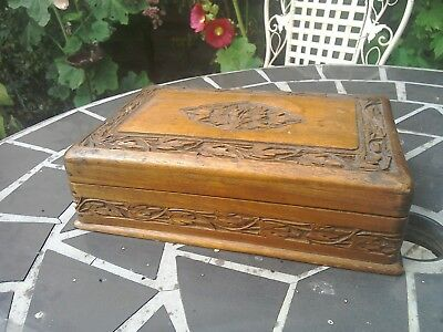 Antique hand carved wooden box.