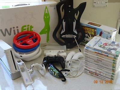 Nintendo Wii console bundle with 13 games and accessories