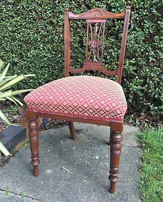 Antique/vintage upholstered mahogany chair with carved back
