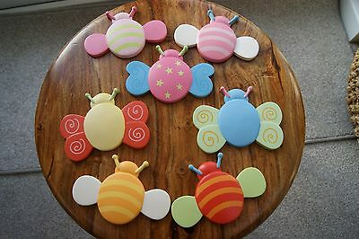 Set of 7 colourful wooden bee and butterfly wall decorations