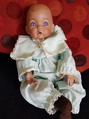 Aaron By Dianna Effner Porcelain Doll Limited Edition Doll has purple eyes