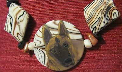 Belgian Malinois hand painted on round Mother of Pearl pendant/bead/necklace