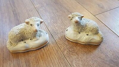 Pair of Staffordshire sheep figures.