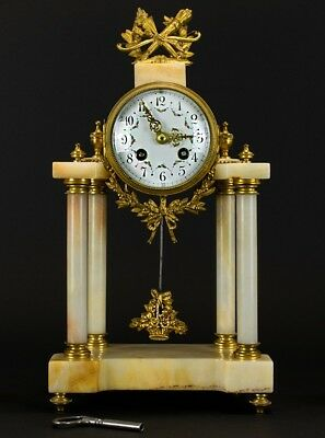A Late 19th Century Onyx Clock French movement Marked Samuel Marti painted ename