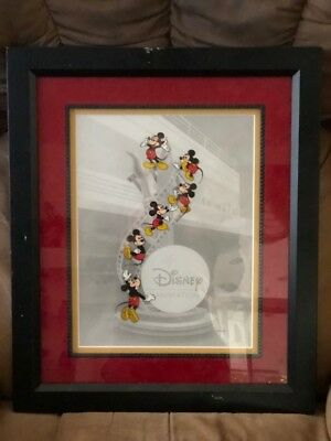 Disney Animation framed cel - Mickey Mouse climbing film strip