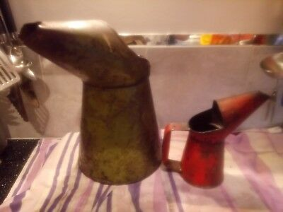 Pair of vintage oil pourers. 1 large 1 gallon green oil pourer and 1 smaller