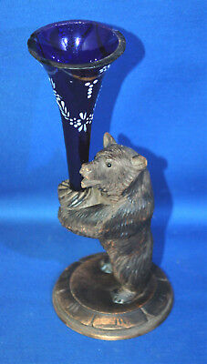 A well carved antique Victorian Black Forest bear figure with decorated epergne