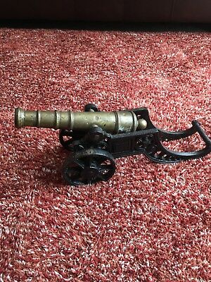 vintage brass cannon on cast iron carriage