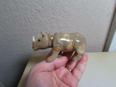 Rhino, Hand carved Stone from the Andes of Peru. Multi Hued Stone Rhinoceros