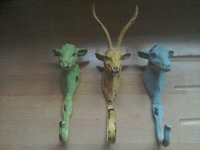Antique / Vintage Cast iron coat hooks in the shape of deer heads
