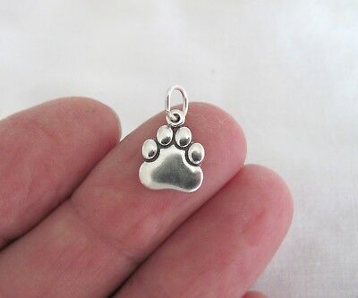 Sterling Silver dog paw small charm.