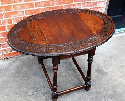 Antique English Solid Oak Small Oval Carved Top Drop Leaf Table