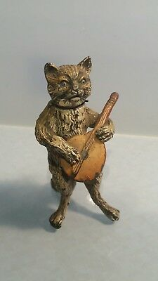A cold painted Novelty figure of a nodding cat playing a mandolin poss Austrian
