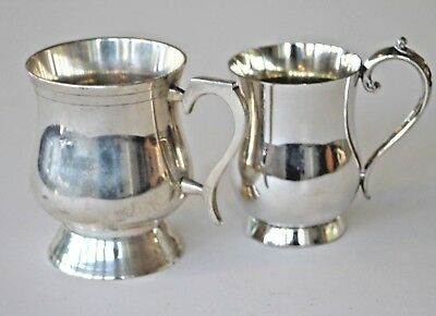 Two vintage small silver plated tankards
