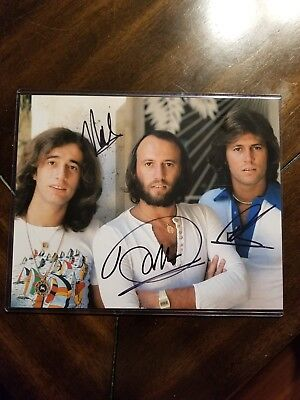 The Bee Gees Signed 10 X 8 Photo   Very Rare  Signed By All 3 Coa