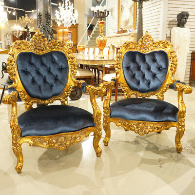 Ornate Heavily Carved French Rococo Arm Chairs in antiqued gold leaf