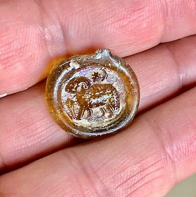 Early byzantine glass pendant with a capricorn. Excellent artifact!