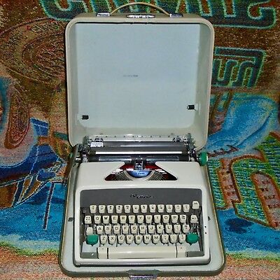 Vintage Olympia SM7 Deluxe Cursive Font Typewriter with the Case - Works Great