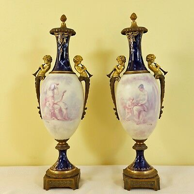 Pair of 19th. c. Signed French Sevres Porcelain and Bronze Figural Urns