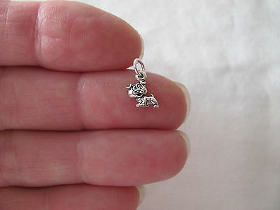 Small Sterling Silver Puppy dog miniature charm.